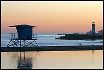 Beach cabin and lighthouse, Twin Lakes State Beach, sunset. Santa Cruz, California, USA