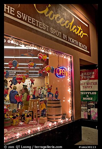 Chocolate store on Columbus Avenue at night, North Beach. San Francisco, California, USA (color)