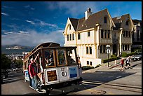 Cable car climbing, and Tudor house, late afternoon. San Francisco, California, USA