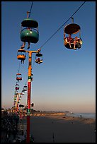 Sky glider Riders enjoy the last sunrays of the day. Santa Cruz, California, USA (color)