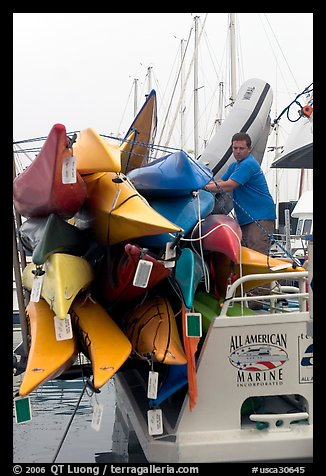 Sea Kayaks attached to a tour boat. California, USA (color)