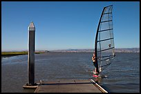 Windsurfer near deck, Palo Alto Baylands. Palo Alto,  California, USA
