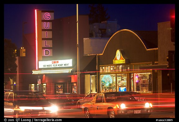 El Camino Real at night, with movie theater and Menlo Clock Works. Menlo Park,  California, USA (color)