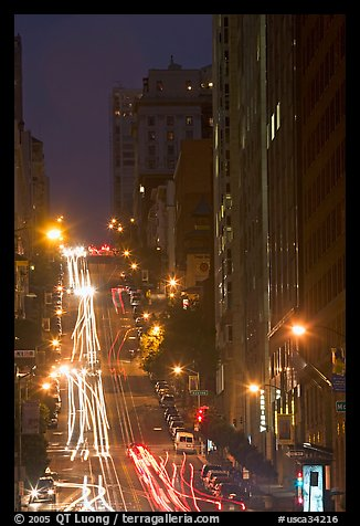 Steep California street and lights at night. San Francisco, California, USA (color)