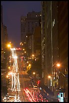 Steep California street and lights at night. San Francisco, California, USA