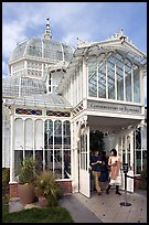 Couple exiting the Conservatory of Flowers. San Francisco, California, USA (color)
