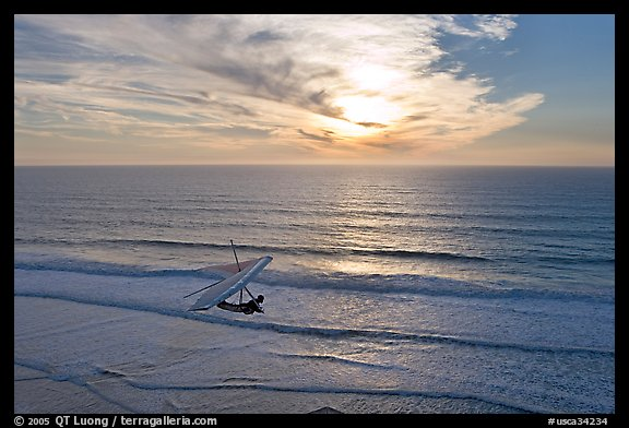 Hang glider flying  above ocean, Fort Funston, sunset. San Francisco, California, USA (color)