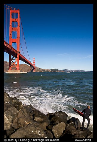Surfer poised to jump in water below the Golden Gate Bridge. San Francisco, California, USA (color)