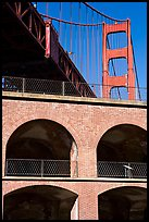 Arched galleries of Fort Point and Golden Gate Bridge pillar. San Francisco, California, USA (color)