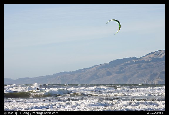 Kite surfer in Pacific Ocean waves, afternoon. San Francisco, California, USA (color)