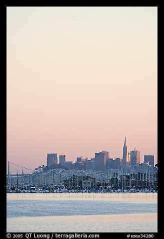 Sausalito houseboats and San Francisco skyline, sunset. San Francisco, California, USA (color)