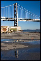 Bay Bridge reflected in water puddles. San Francisco, California, USA ( color)