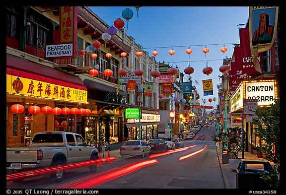 Lanterns and lights on Grant Street at dusk, Chinatown. San Francisco, California, USA (color)