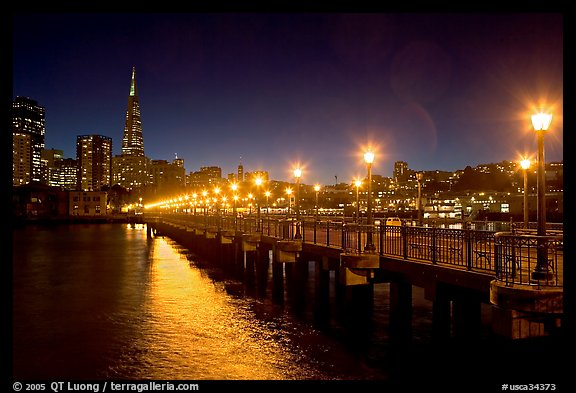 Skyline, Pier 7 lights and reflections at night. San Francisco, California, USA (color)