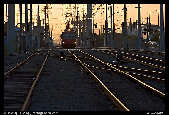 Railroad tracks, train, and power lines, sunrise. San Diego, California, USA (color)