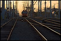 Railroad tracks, train, and power lines, sunrise. San Diego, California, USA ( color)