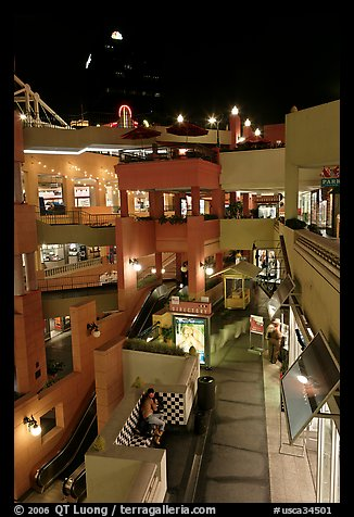 Some of the 140 stores in the Horton Plaza shopping mall at night. San Diego, California, USA (color)