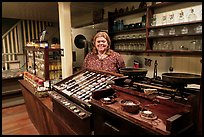 Woman standing behind counter of apothicary store, Old Town. San Diego, California, USA ( color)