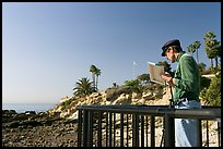Painter working from an overlook. Laguna Beach, Orange County, California, USA ( color)