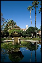 Palm trees reflected in central  courtyard basin. San Juan Capistrano, Orange County, California, USA