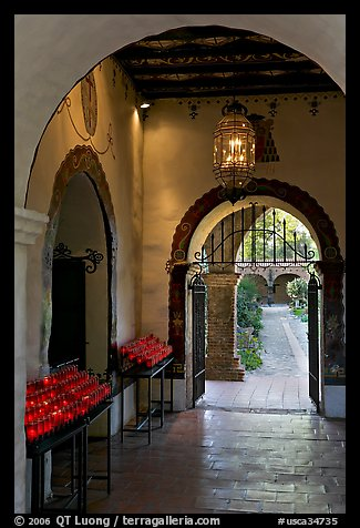Corridor with candles next to the Serra Chapel. San Juan Capistrano, Orange County, California, USA (color)