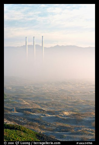 Chimneys of power plant emerging from the fog. Morro Bay, USA (color)