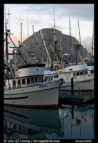 Fishing boats and Morro Rock, sunrise. Morro Bay, USA (color)