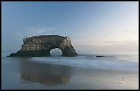 Sea arch and reflection, Natural Bridges State Park, dusk. Santa Cruz, California, USA