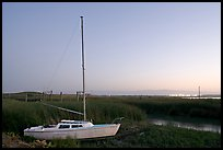 Yacht and marsh at dusk, Alviso. San Jose, California, USA (color)