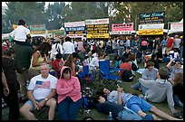 Crowd sitting on the grass in Guadalupe River Park, Independence Day. San Jose, California, USA (color)