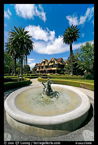 Wide view of fountain and mansion. Winchester Mystery House, San Jose, California, USA (color)