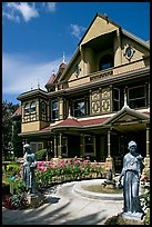 Statues, fountain, and facade. Winchester Mystery House, San Jose, California, USA ( color)