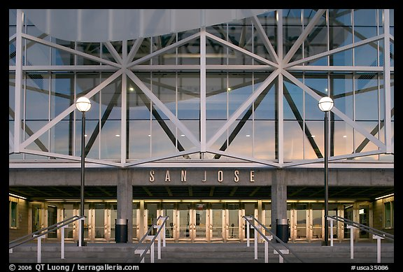 Facade of HP pavilion with San Jose sign reflecting sunset colors. San Jose, California, USA (color)