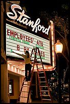 Woman changing movie title, Stanford Theatre. Palo Alto,  California, USA (color)