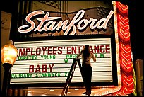Neon signs and movie title being rearranged, Stanford Theater. Palo Alto,  California, USA (color)