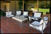Chairs and coffee table on porch, Sunset gardens reflected. Menlo Park,  California, USA ( color)