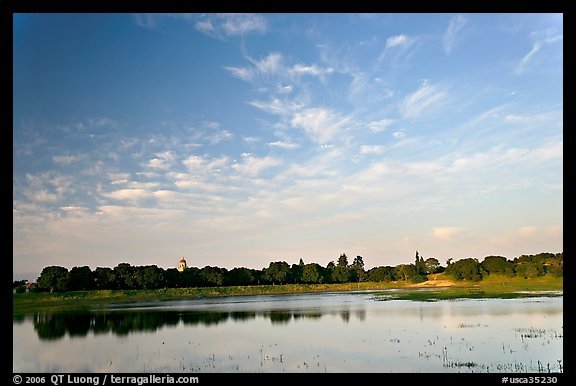 Lake Lagunata and Hoover tower behind row of trees, late afternoon. Stanford University, California, USA (color)