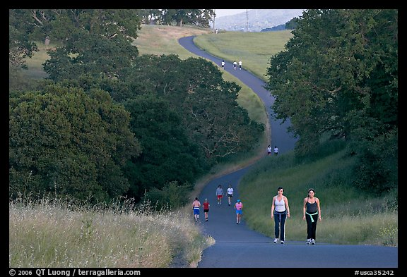 Women walking on trail, Stanford academic preserve. Stanford University, California, USA (color)