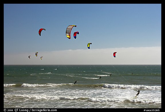 Group of kitesurfers, Waddell Creek Beach. California, USA (color)
