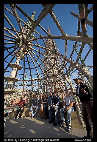 Tour guide and group in the Gazebo of the Watts Towers. Watts, Los Angeles, California, USA (color)