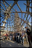 Tour guide and group in the Gazebo of the Watts Towers. Watts, Los Angeles, California, USA ( color)