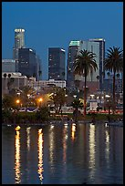 Skyline reflected in a lake in Mc Arthur Park. Los Angeles, California, USA