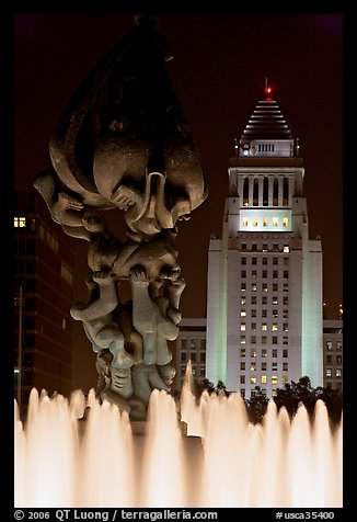 Peace on Earth sculpture, fountain, and City Hall at night. Los Angeles, California, USA (color)