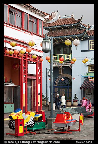 Rides and buildings in Chinese style, Chinatown. Los Angeles, California, USA (color)