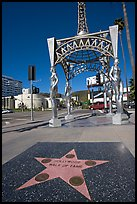 Star from the Hollywood walk of fame and gazebo with statues of actresses. Hollywood, Los Angeles, California, USA (color)