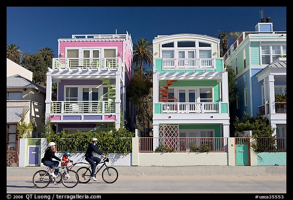 Family Cycling In Front Of Colorful Beach Houses Santa Monica Los Angeles