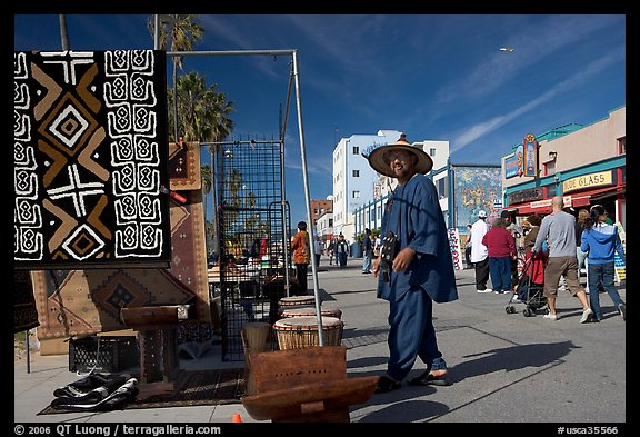 Man selling crafts on Venice Boardwalk. Venice, Los Angeles, California, USA (color)