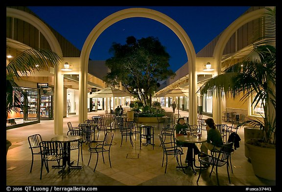Sitting at outdoor table at night, Stanford Shopping Center. Stanford University, California, USA (color)