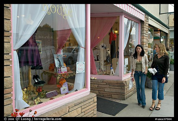Women walking by storefront on Main Street. Half Moon Bay, California, USA (color)