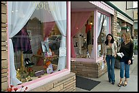 Women walking by storefront on Main Street. Half Moon Bay, California, USA ( color)
